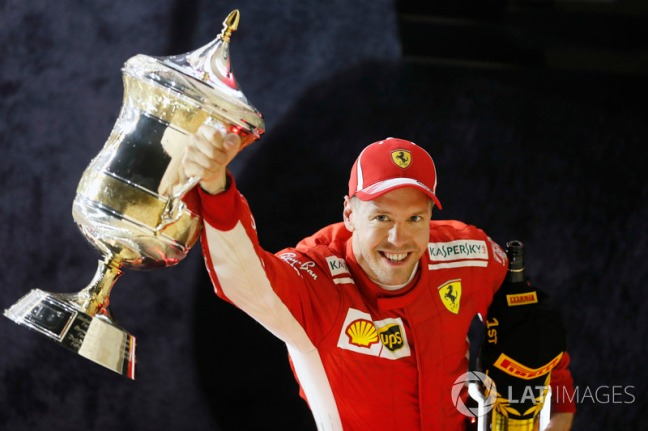 f1-bahrain-gp-2018-sebastian-vettel-ferrari-1st-position-celebrates-with-his-trophy